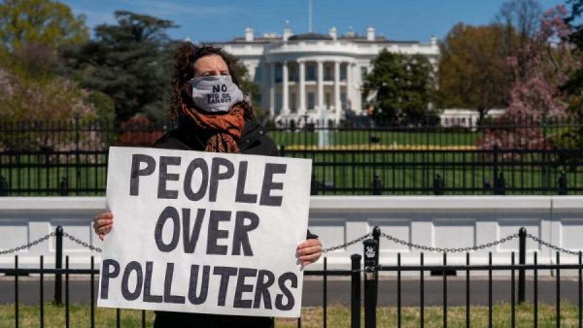 People over polluters protestor White House