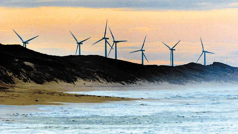 Wind turbines behind a beach