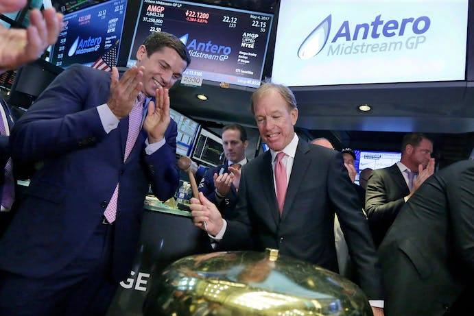 Antero Midstream CEO Paul Rady, right, alongside then-NYSE Group President Tom Farley, rings a ceremonial bell at the New York Stock Exchange after his company's initial public offering in May 2017.