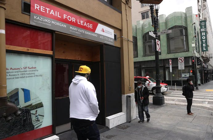 Pedestrians walk by retail spaces for lease last week in San Francisco. More than 2,000 businesses have closed in the Bay Area because of pandemic restrictions.