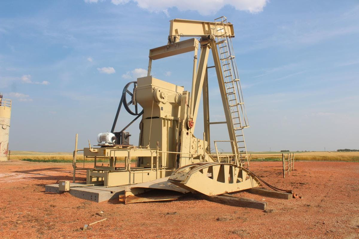 An out-of-use pumpjack sits on a well site that hasn't been reclaimed in decades.