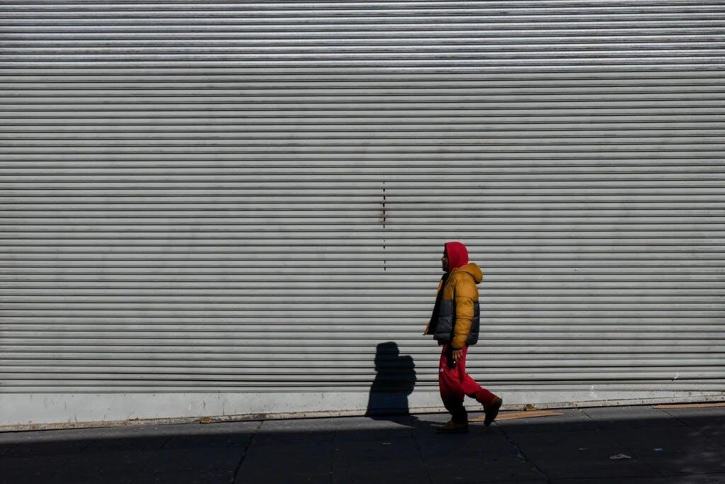 man walking sidewalk wall
