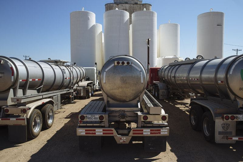 Tanker trucks sit in front of storage silos in Sunray, Texas, on Sept. 26, 2020.