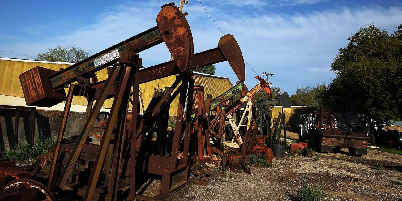 Rusted out 'pump-jacks' are viewed on March 26, 2015 in the oil town of Luling, Texas. S