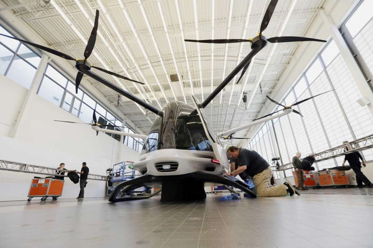 Workers prepare the Skai vehicle, developed by Alaka'i Technologies, for a special unveiling in Newbury Park, Calif. The transportation company is betting its hydrogen-powered electric flying vehicles will someday serve as taxis, cargo carriers and ambulances of the sky.