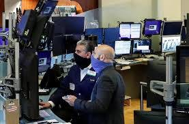 Traders at New York Stock Exchange wear masks