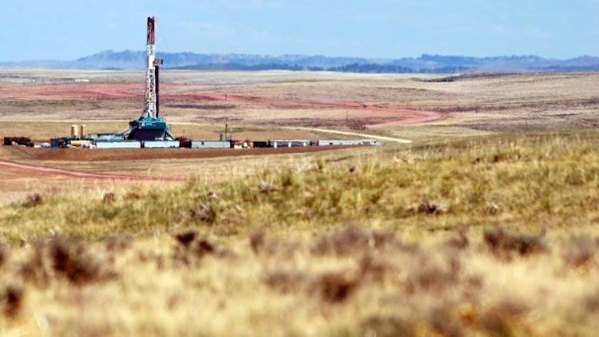 oil rig in field Wyoming