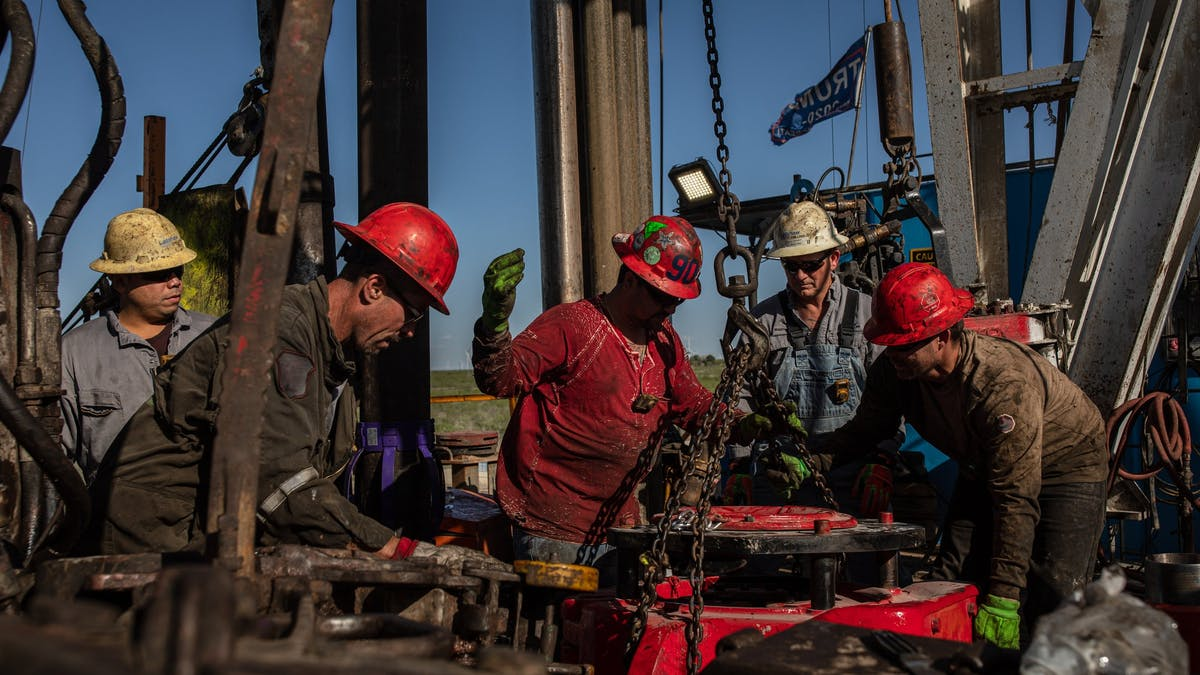 Oil workers at a drilling rig in Texas