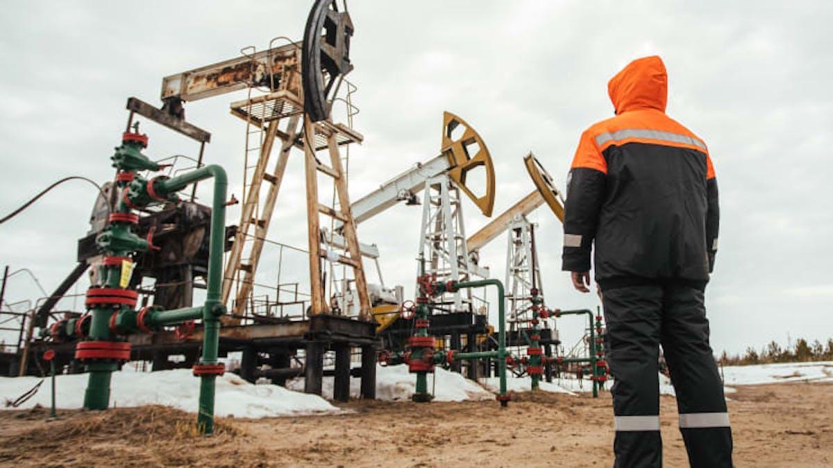 A Surgutneftegas worker near pumpjacks in Surgut Region of the Khanty-Mansi Autonomous Area - Yugra, in the West Siberian petroleum basin.