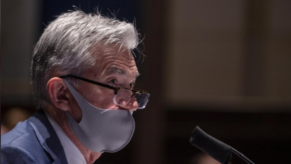 Federal Reserve Chairman Jerome Powell, wearing a face mask, testifies before the House of Representatives Financial Services Committee during a hearing on oversight of the Treasury Department and Federal Reserve response to the outbreak of the coronavirus disease (COVID-19), on Capitol Hill in Washington, U.S., June 30, 2020.
