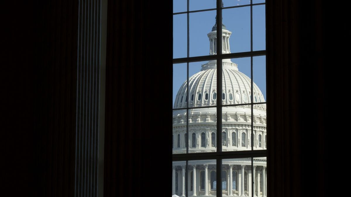 US Capitol through window