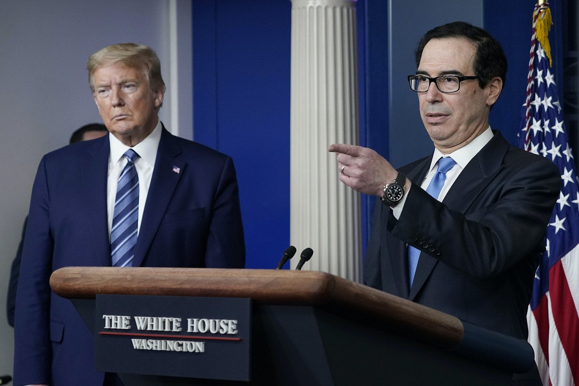 Treasury Secretary Steven Mnuchin takes questions as President Trump looks on