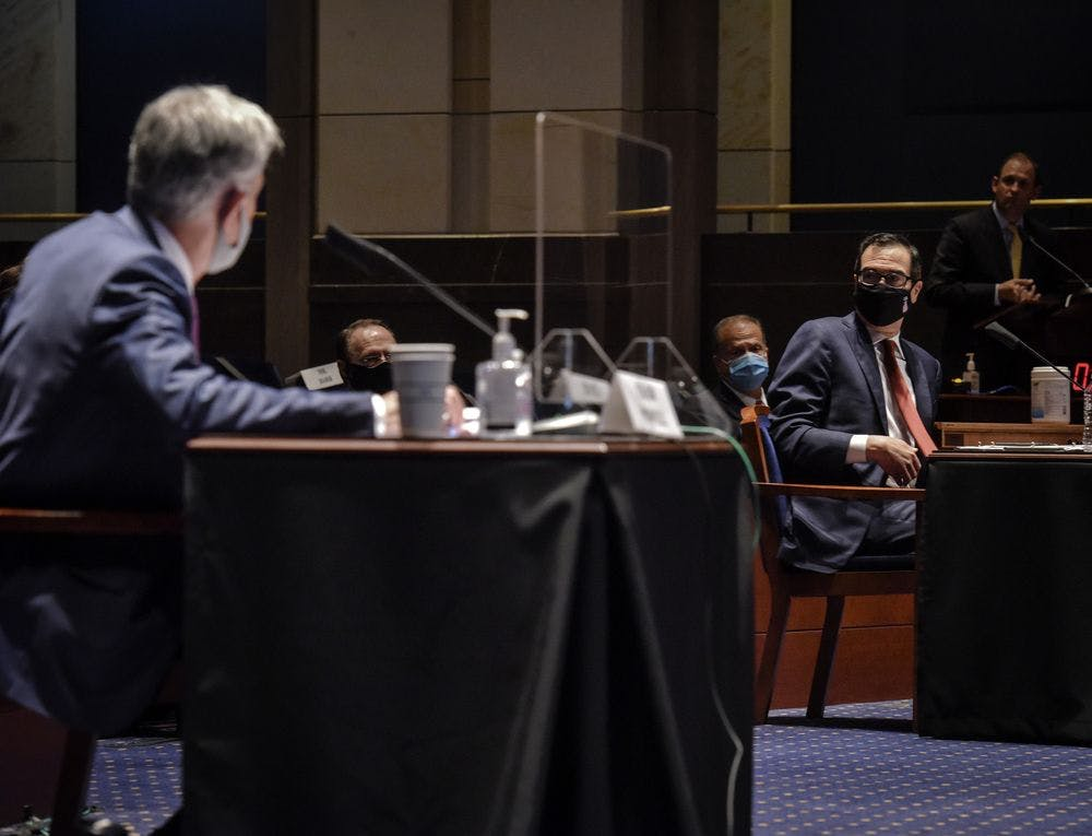 Jerome Powell, left, and Steven Mnuchin during the House Committee on Financial Services hearing on Oversight of the Treasury Department and Fed Reserve Pandemic response, on June 30.