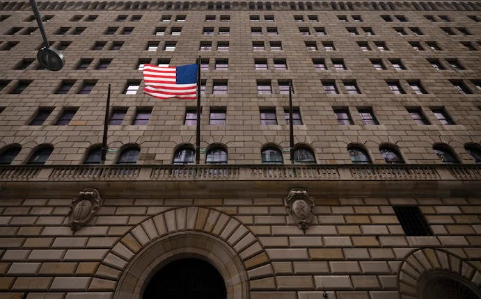 The U.S. flag hangs on the Federal Reserve Bank of New York in August.