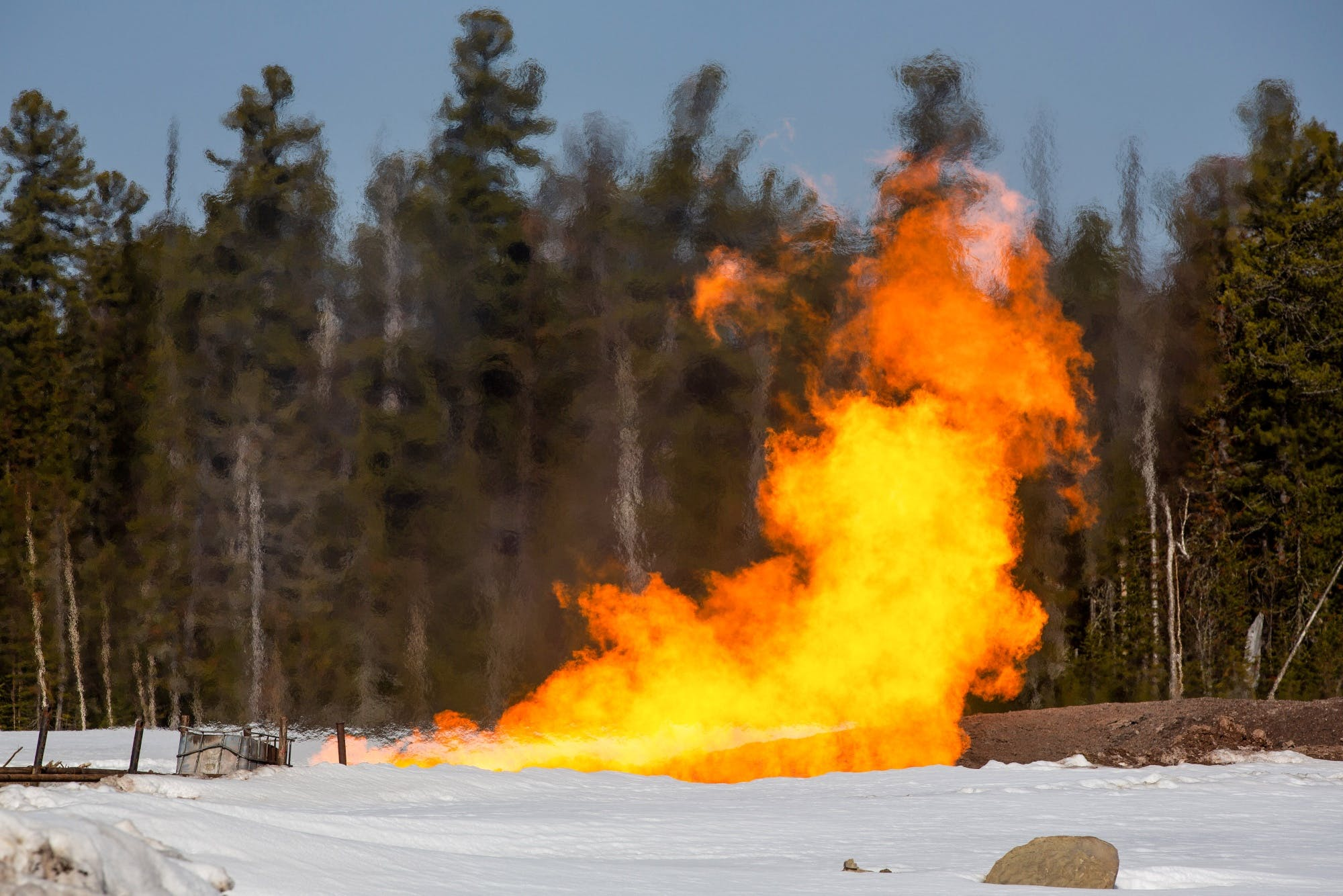 gas flare forest snow