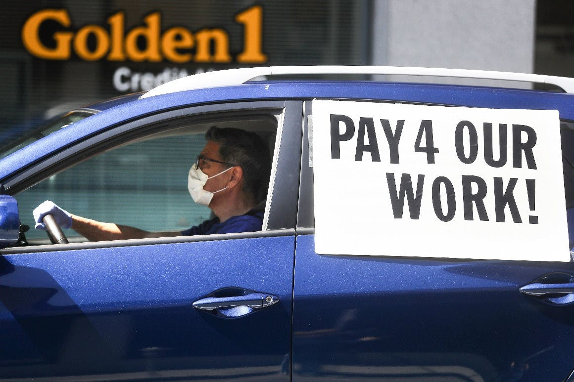 A driver protests with a rideshare union