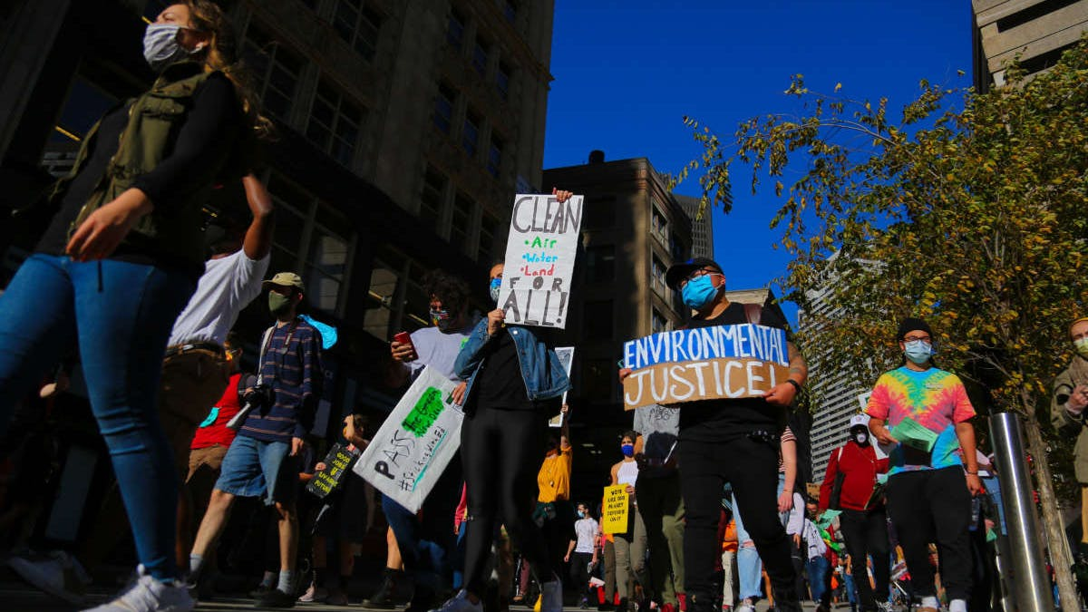 Protesters gather at Boston City Hall and march through downtown to demand immediate action for climate justice in Boston, Massachusetts, on October 15, 2020.