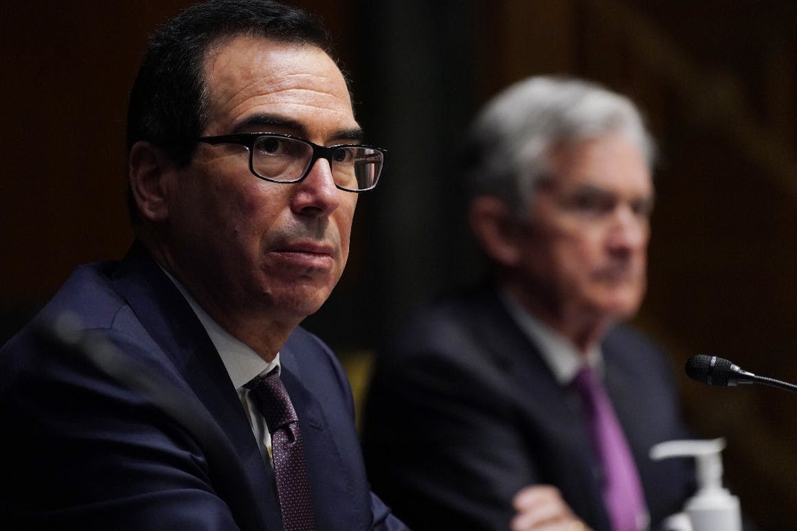 Treasury Secretary Steven Mnuchin and Federal Reserve Chair Jerome Powell are seen during a congressional hearing.