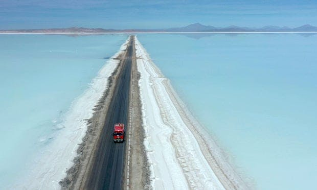 Aerial view of a truck on a road crossing the flooded southern zone of the Uyuni salt flat in Bolivia