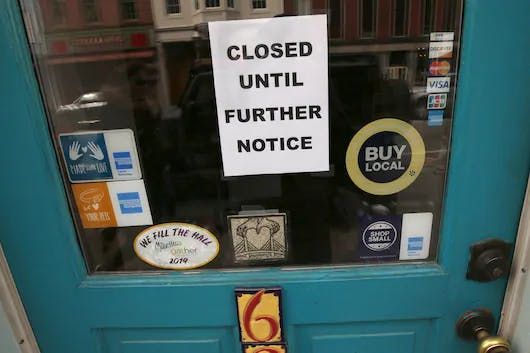 "A ""closed"" sign hangs in the window of a shop in Portsmouth, N.H. on March 25 due to coronavirus concerns."