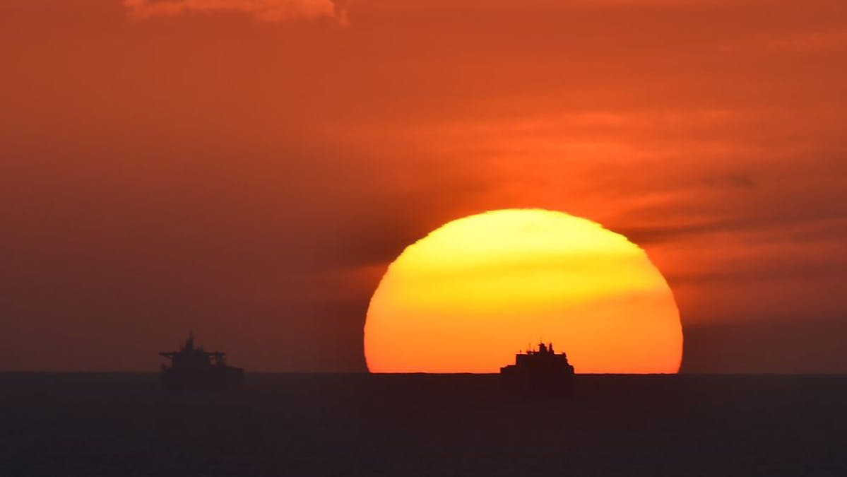 Offshore drilling at sunset