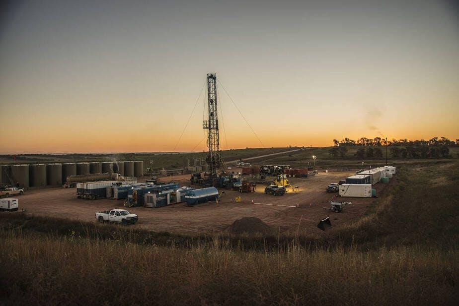 Activity at a Bakken oil well pad south of Watford City, North Dakota.
