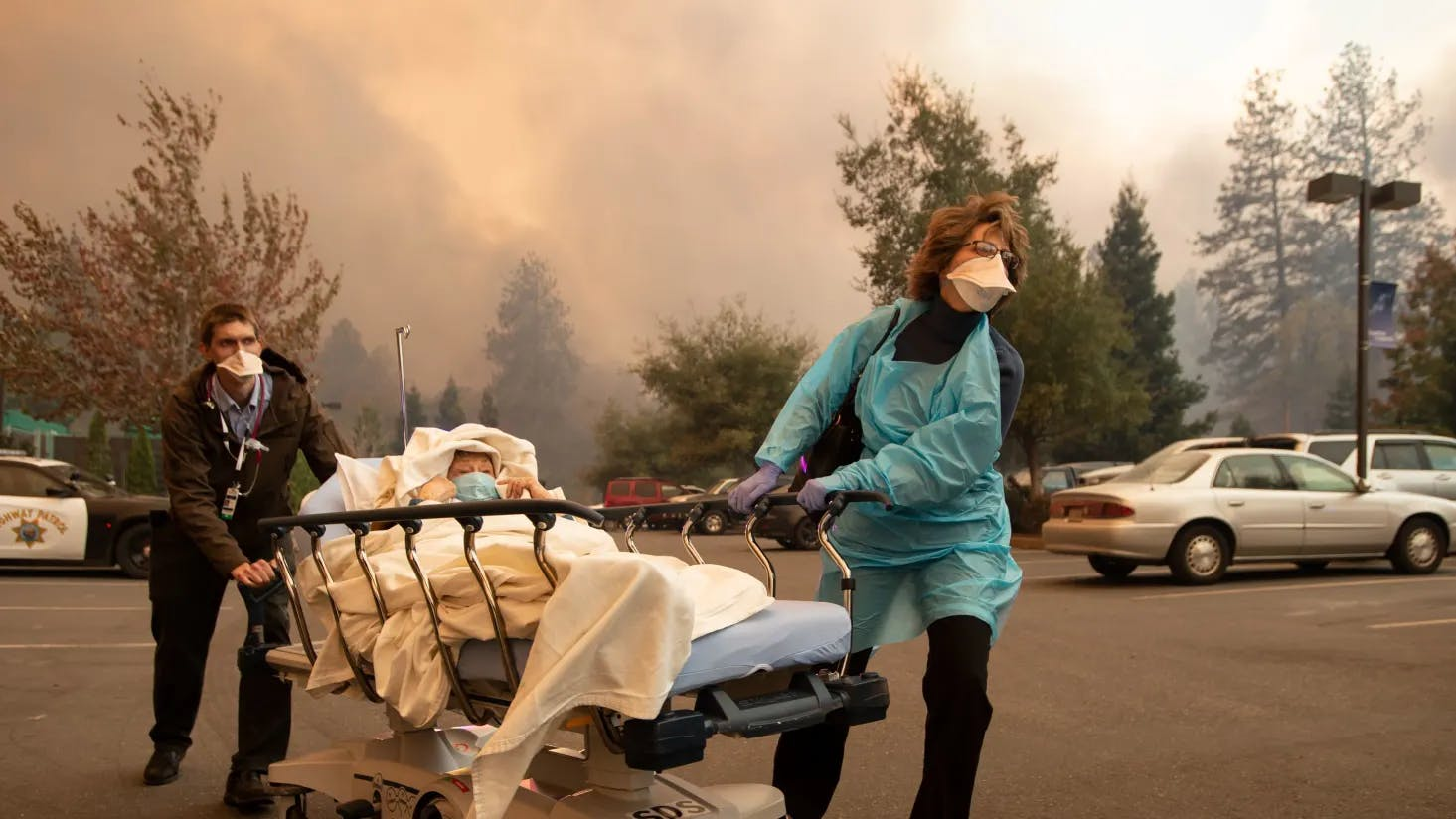 Patients are quickly evacuated from the Feather River Hospital as it burns down during the Camp fire in Paradise, California