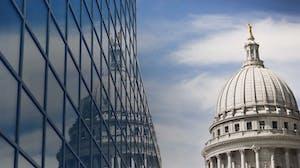 Capitol building reflected in skyscraper windows
