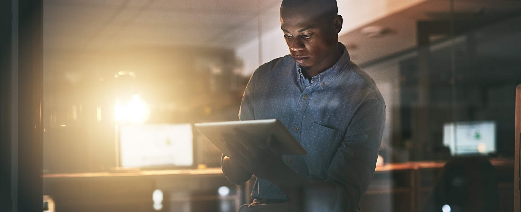 Small business owner accesses PPP funding portal on his computer