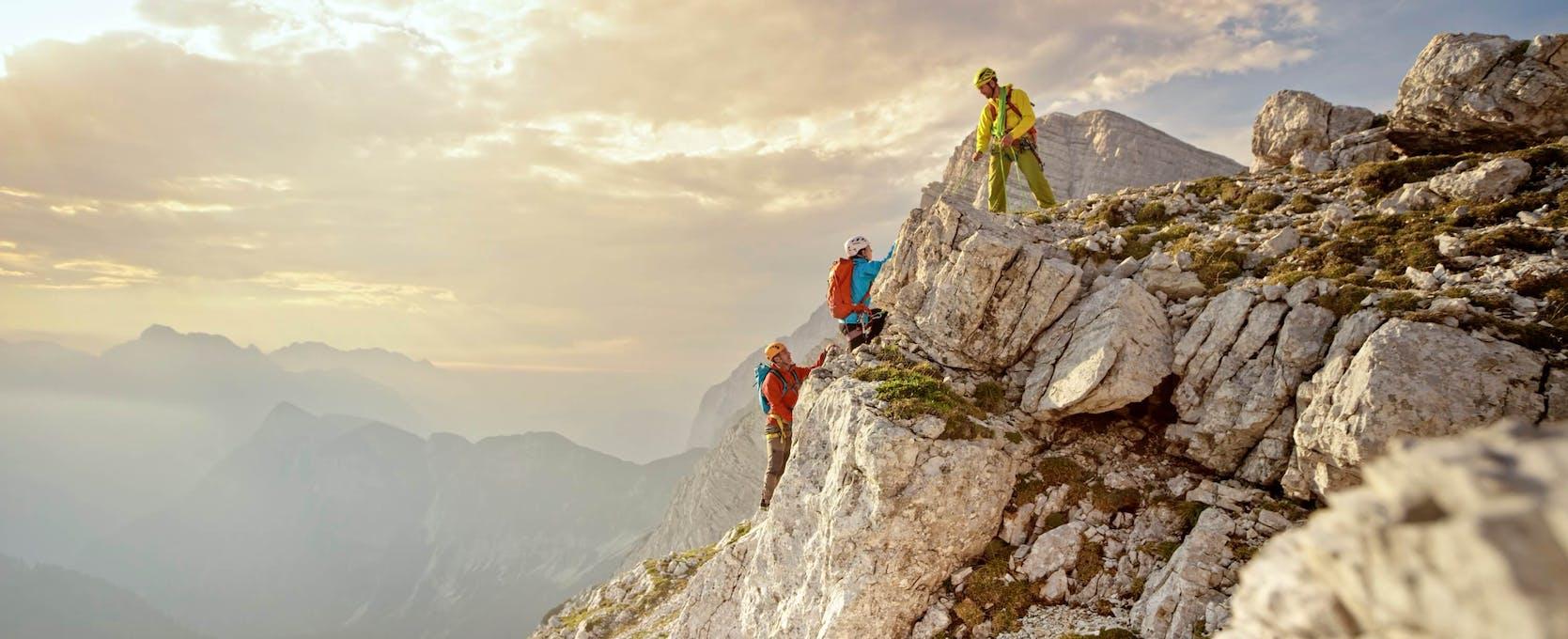 Climbers move forward avoiding risks to reach their goal, the summit