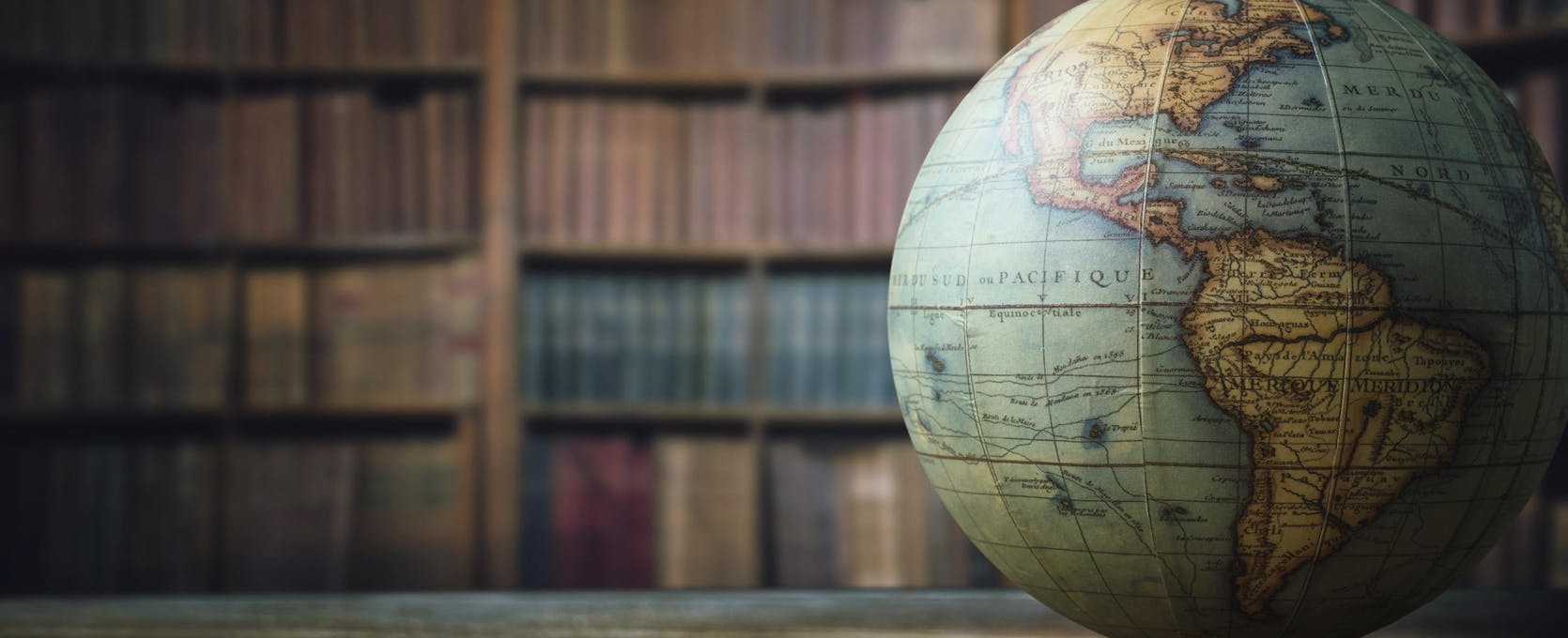 A globe on the desk of an international business professional