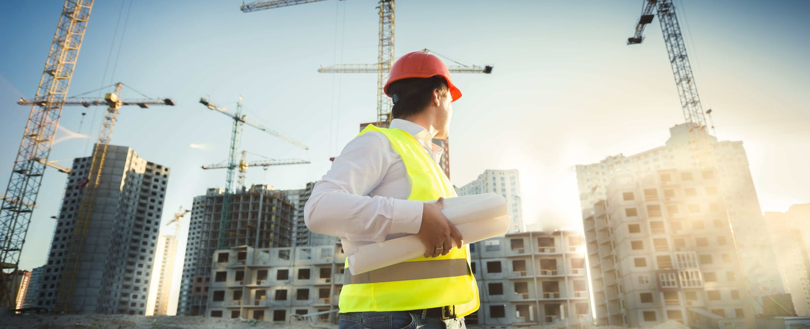 Construction industry professional overseeing a commercial construction project
