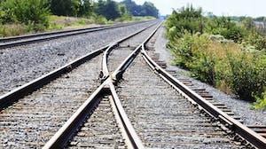 Two rail roads merge en route