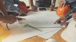 Construction crew reviewing blueprints