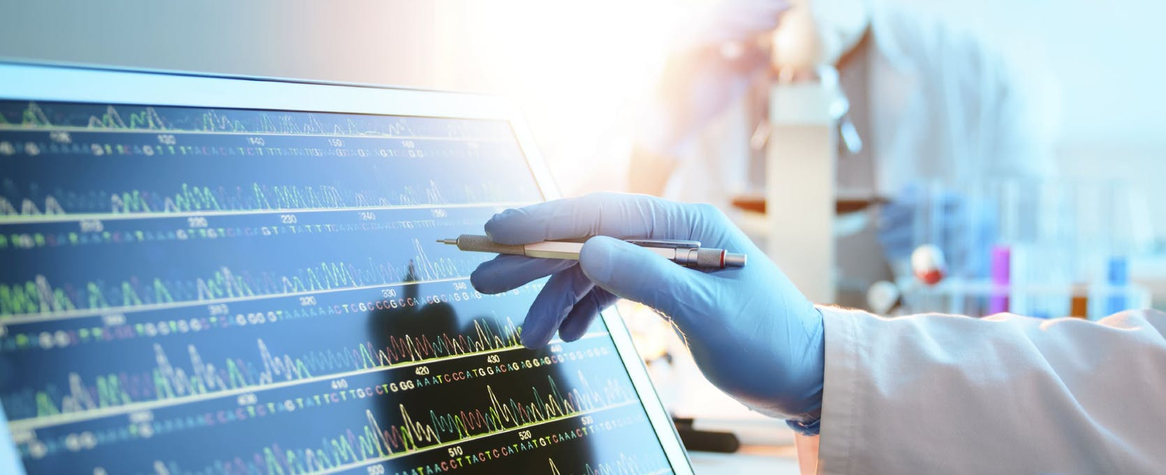 Medical technician analyzes data in a healthcare lab