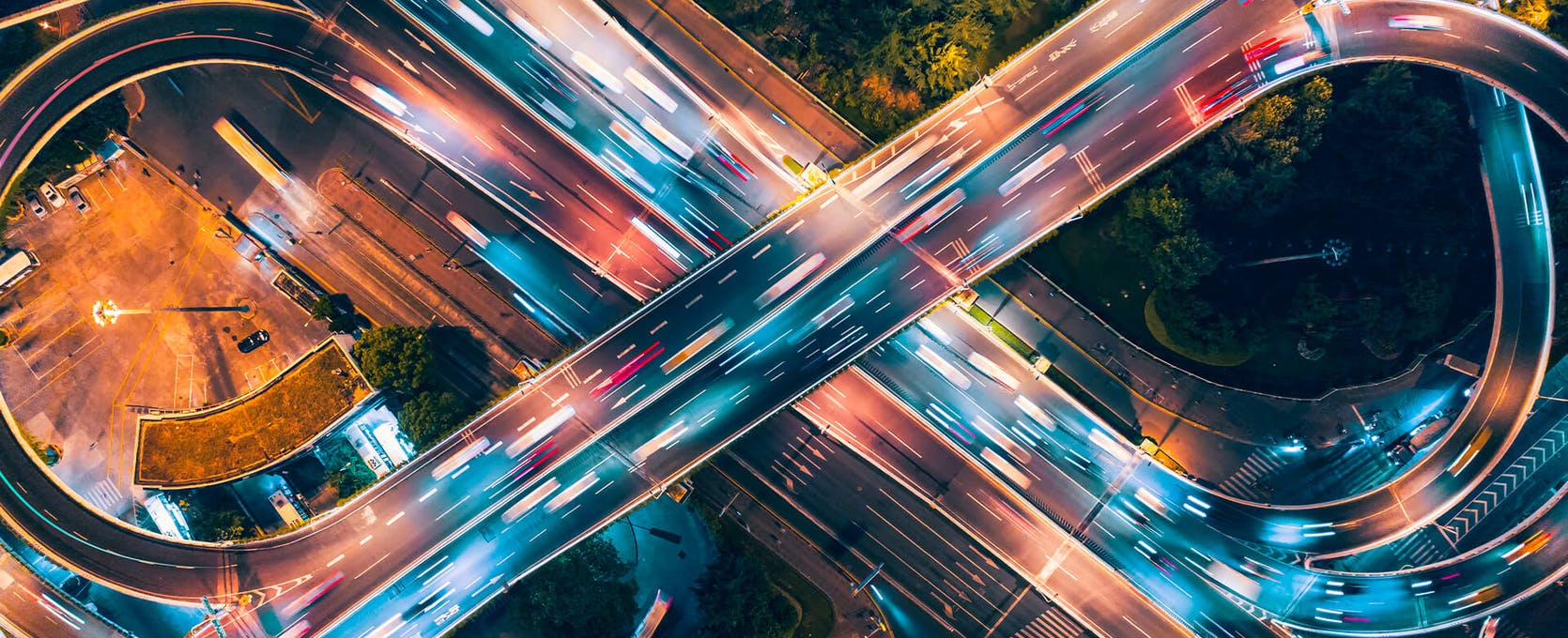 Aerial view of cars driving over highway at night