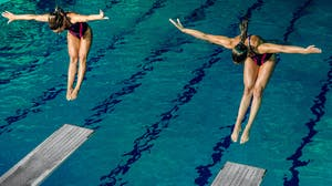 Colleges students participating in diving competition