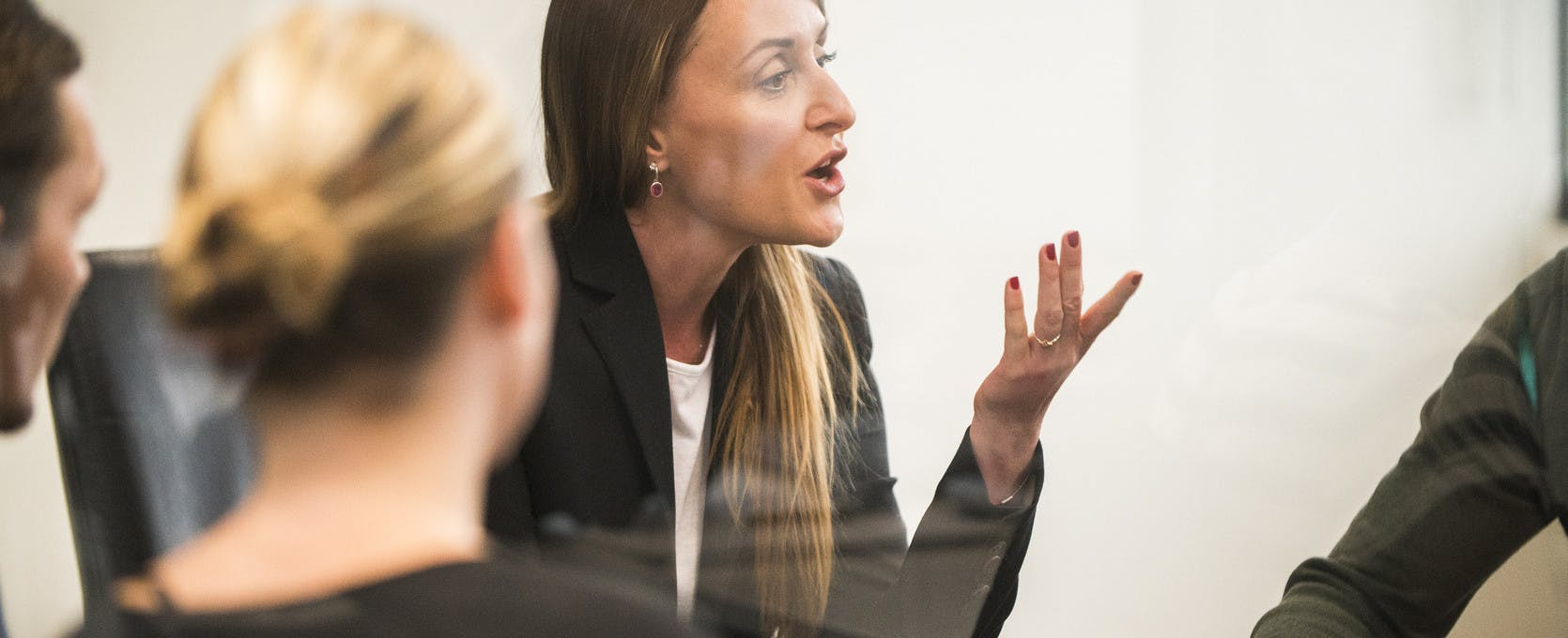 Woman speaking at a meeting