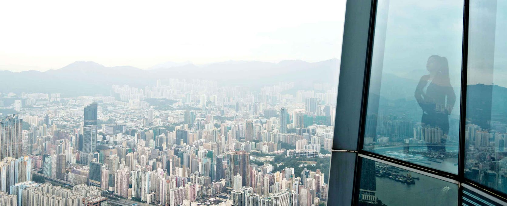Real estate developer looks at city from above