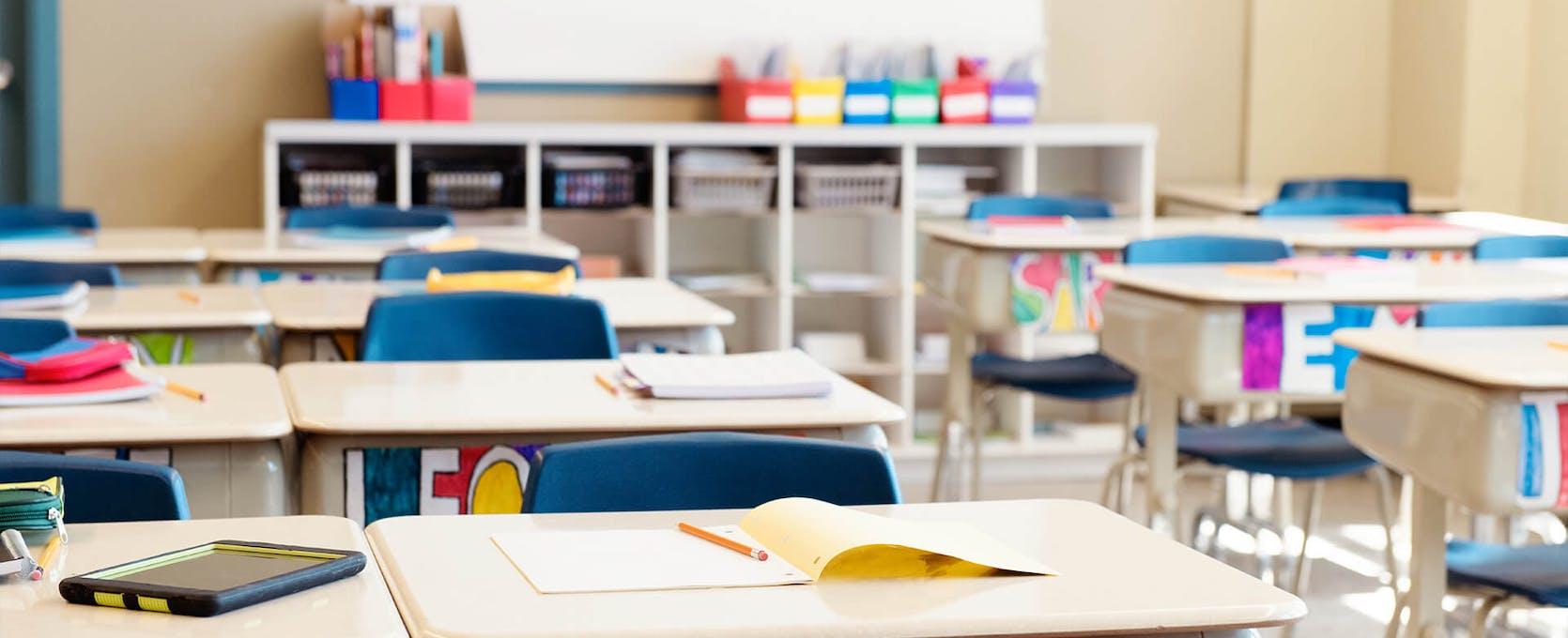 Empty desks in elementary school classroom