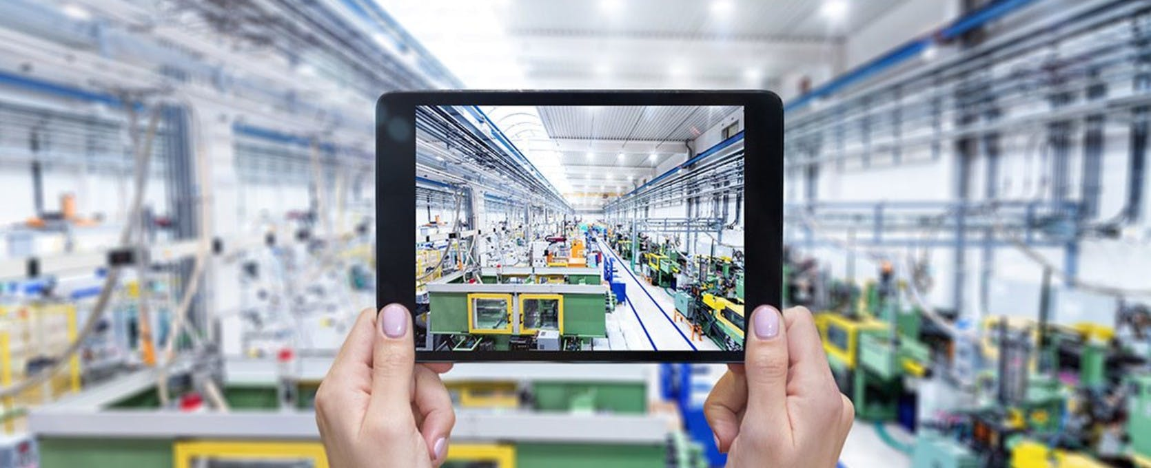 Taking a picture of an industrial workspace on a tablet