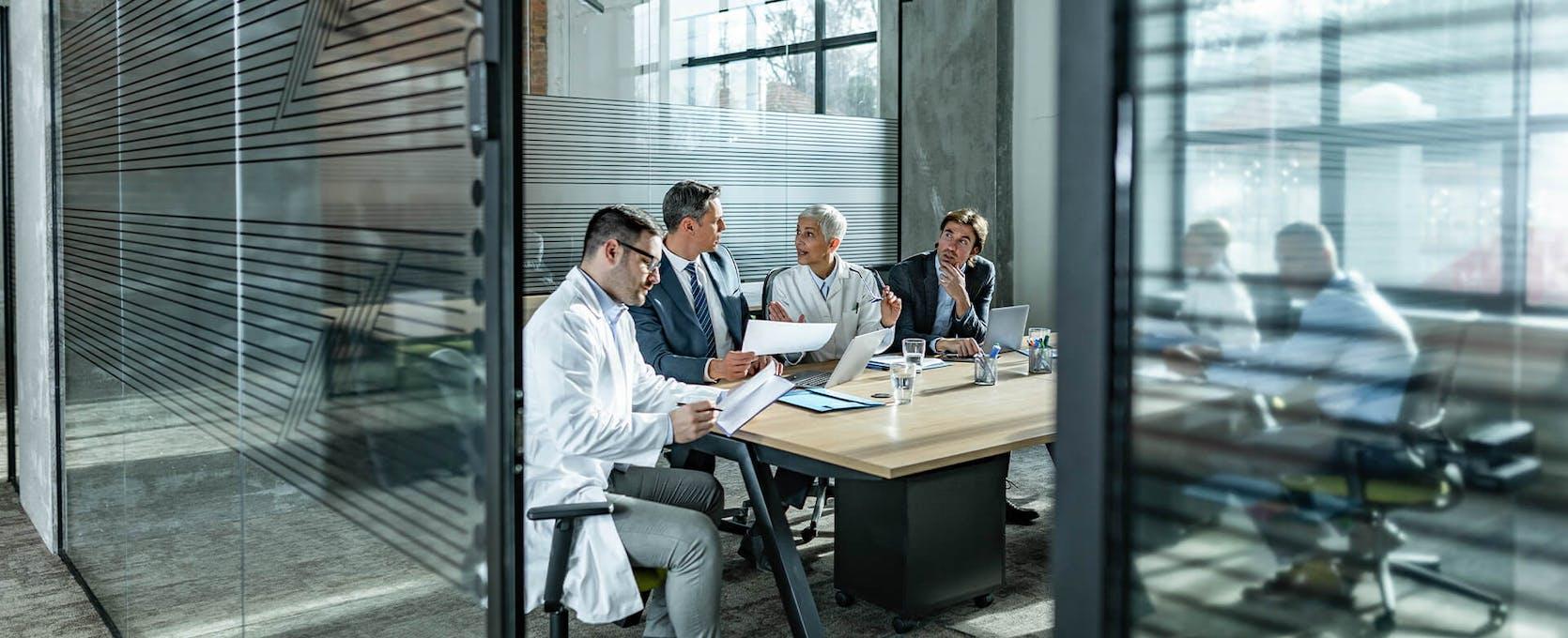 Life sciences management team meets to discuss fair market value compensation
