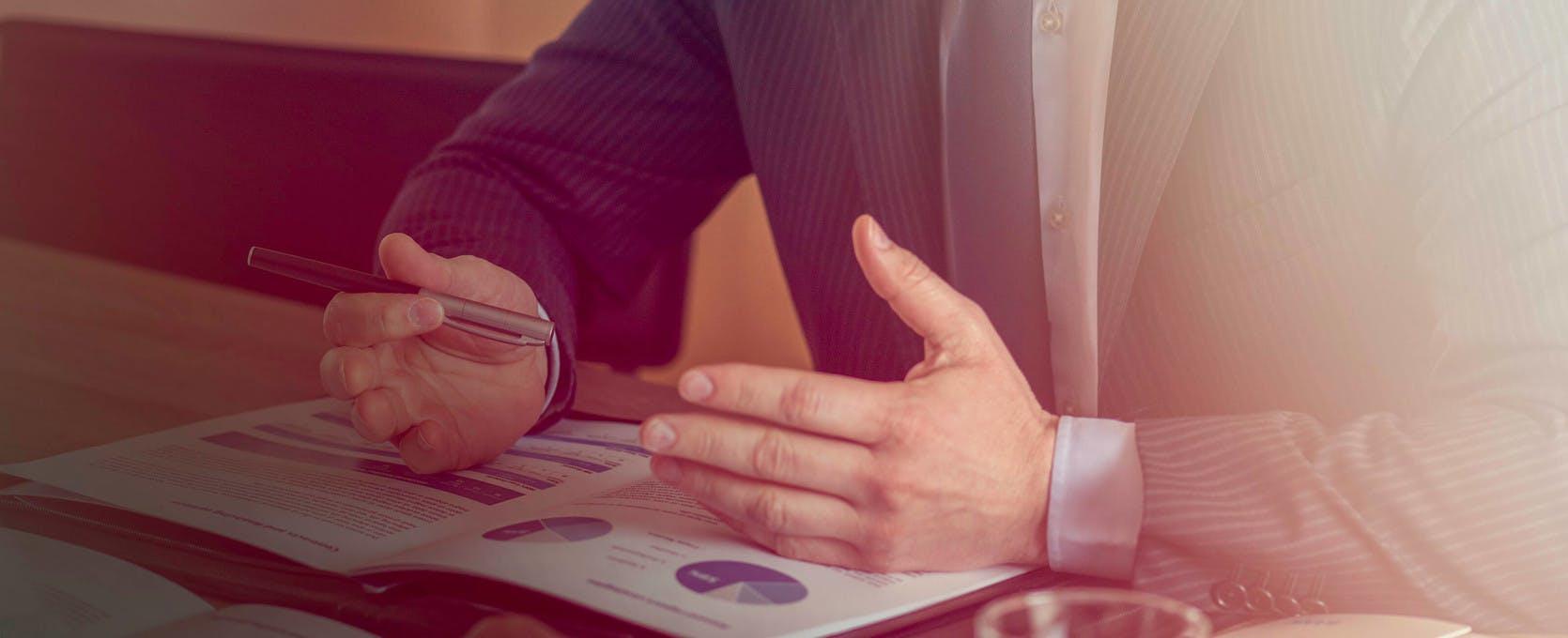 Man explaining data at a business meeting