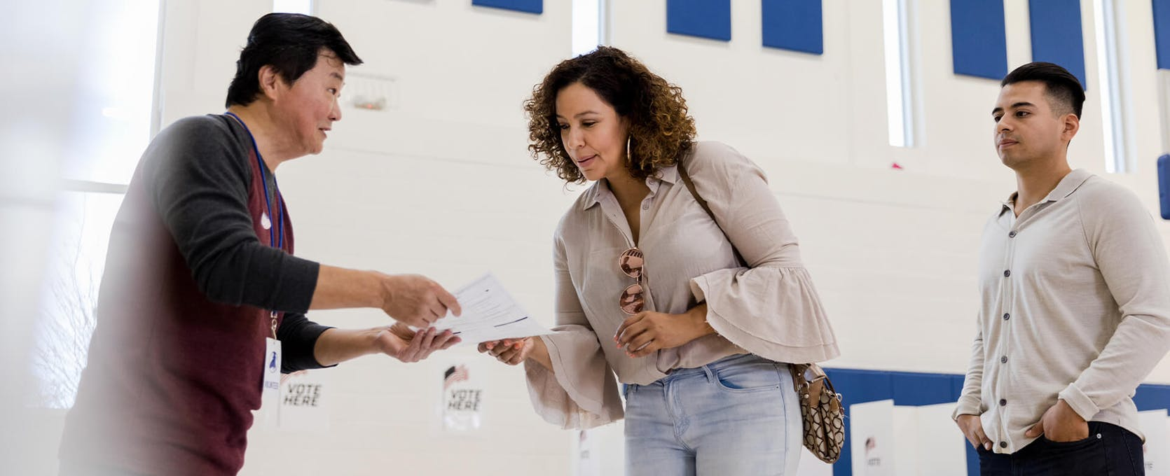 Community members submit ballots on voting day