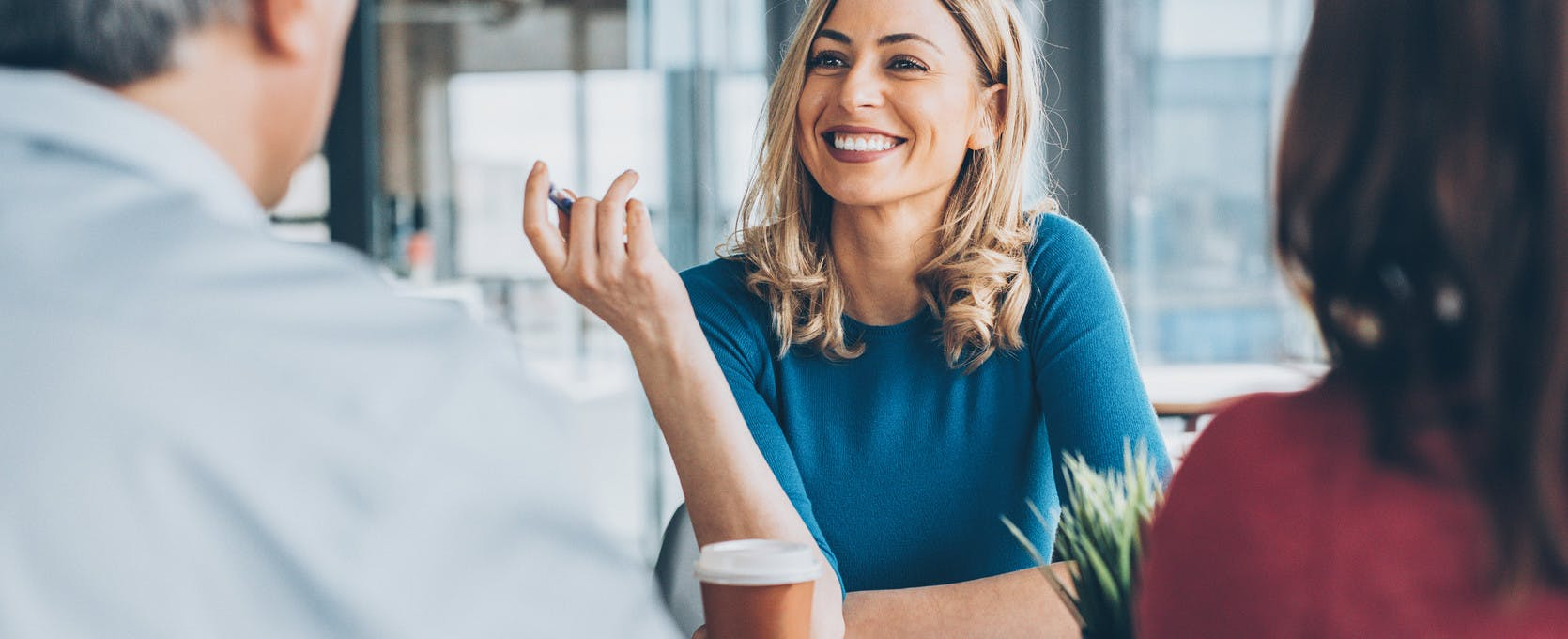 Woman smiling at her team during a business meeting