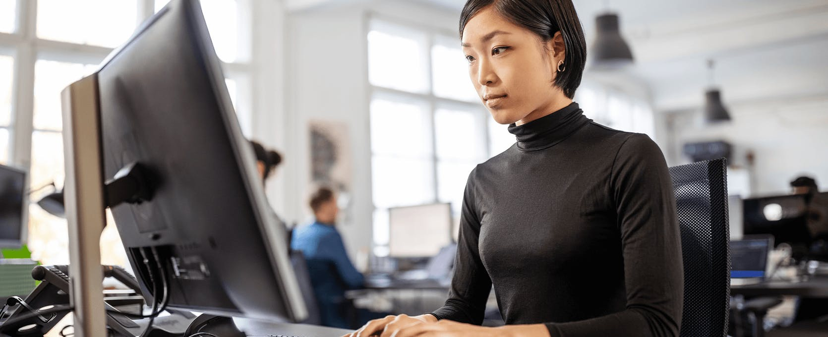 Business professionals works at office computer