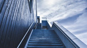 Exterior stairs lead up signifying the future, recovery