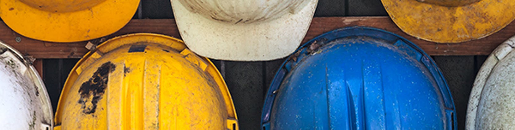 Colorful hard hats on a wall