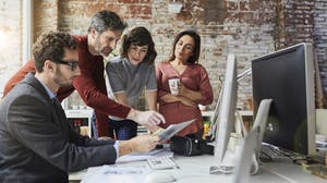Team collaborates on a client campaign brief