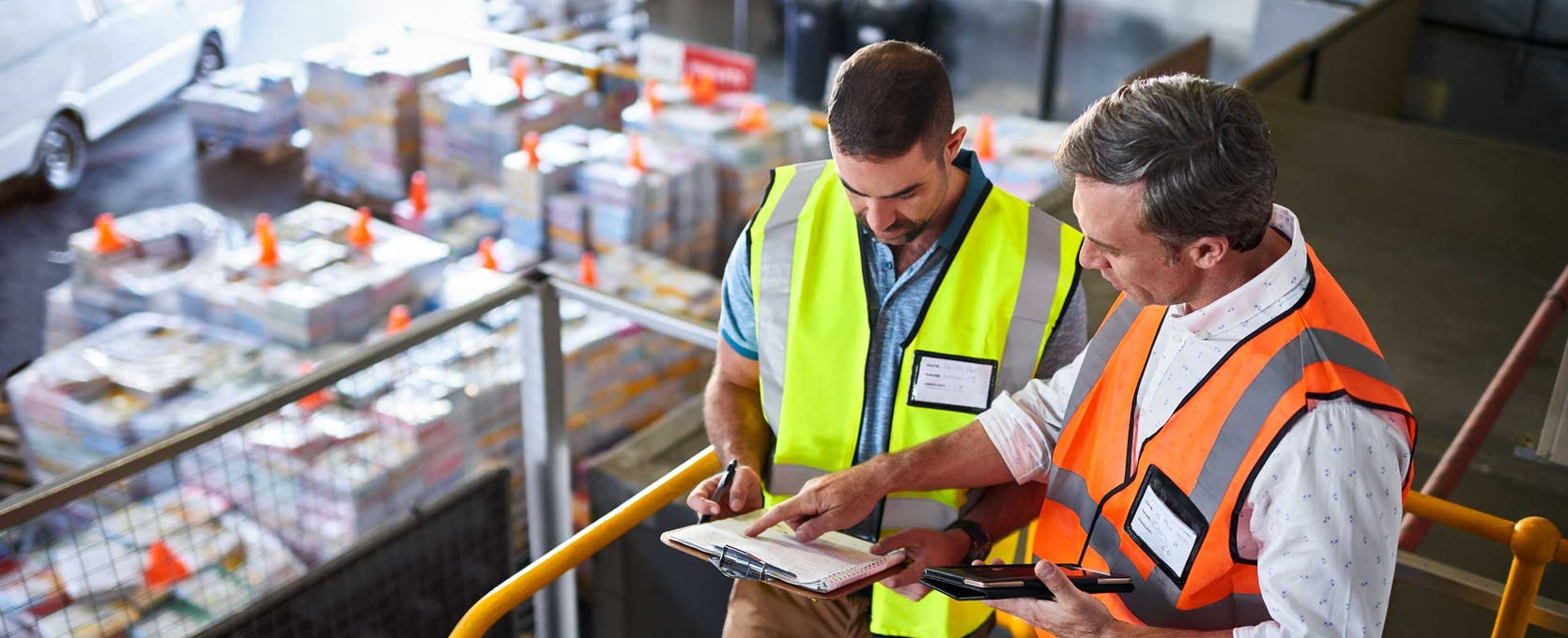 Employees discuss supply chain strategy